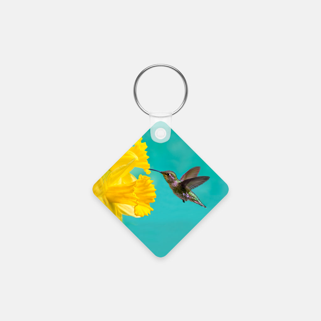 Daffodil photograph printed on a square key chain.