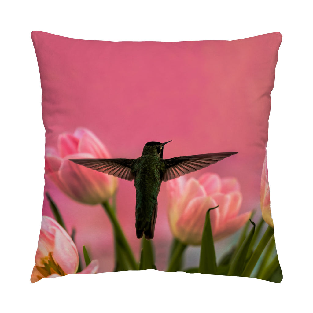 "Guarding The Tulips hummingbird photograph on a 16"" square pillow."