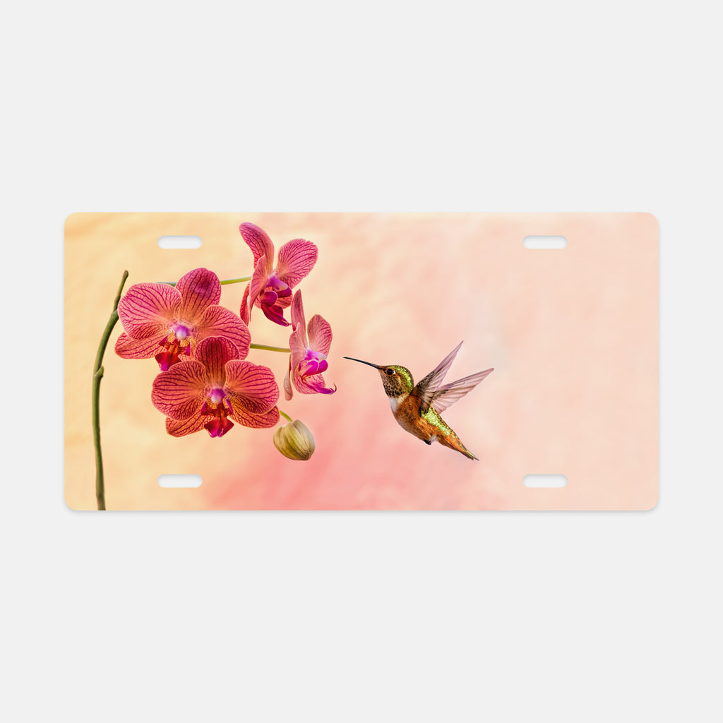 Orchid Attraction 4 photograph printed on a license plate.
