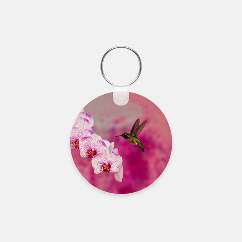 Orchid Attraction 2 photograph printed on a round key chain.