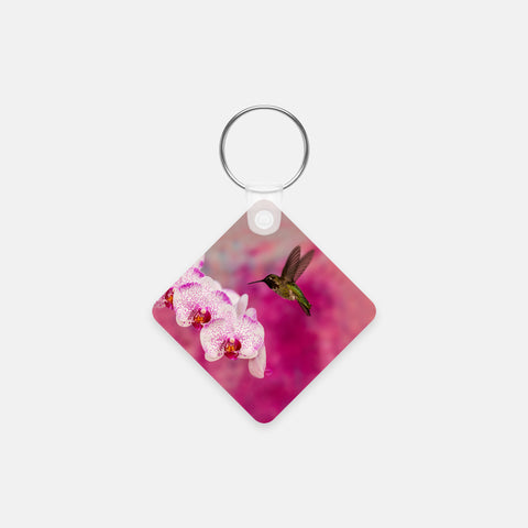 Orchid Attraction 2 photograph printed on a square key chain.