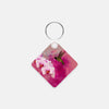 Image of Orchid Attraction 2 photograph printed on a square key chain.