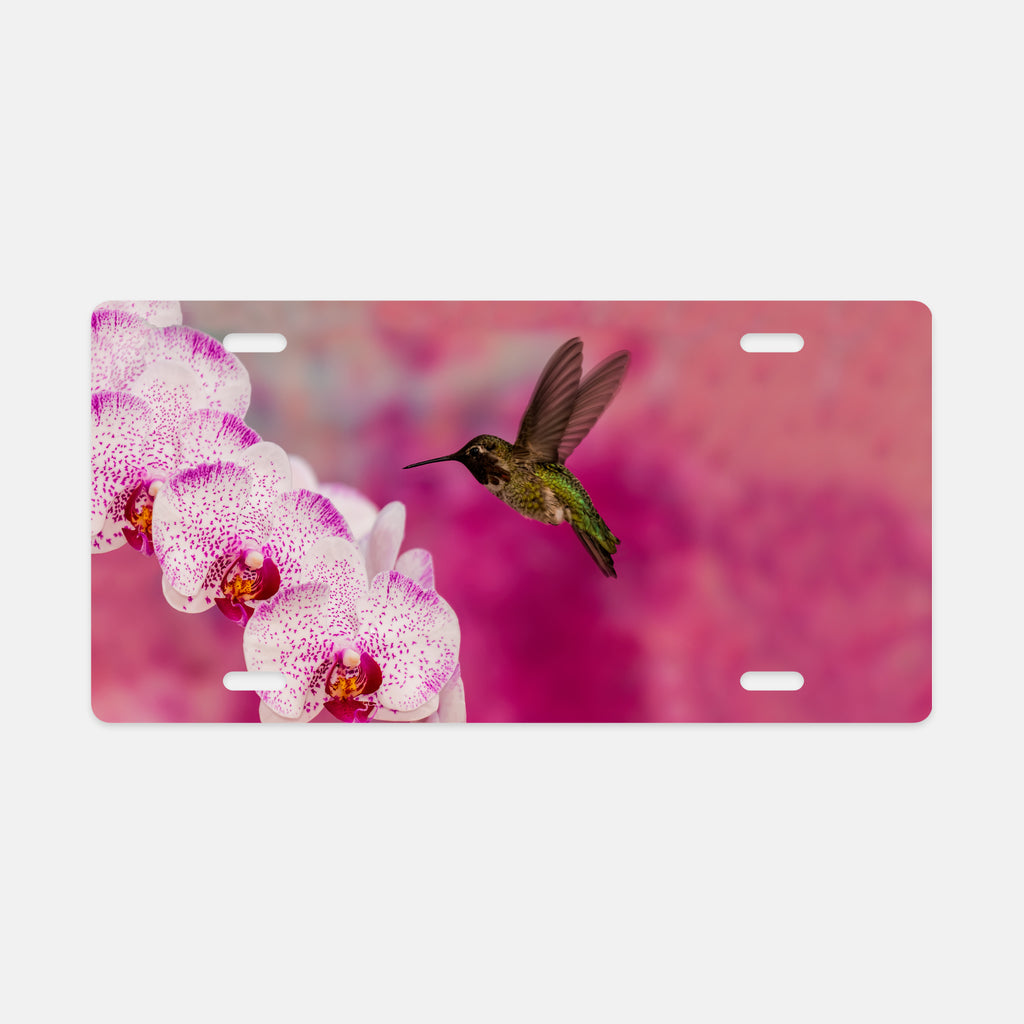 Orchid Attraction 2 photograph printed on a license plate.