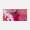 Image of Orchid Attraction 2 photograph printed on a license plate.