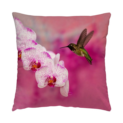 "Orchid Attraction 2 hummingbird photograph on a 16"" square pillow."