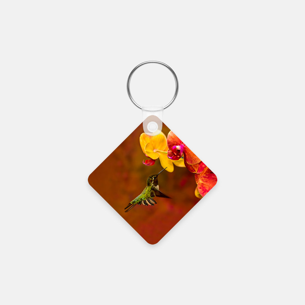 Orchid Attraction photograph printed on a square key chain.