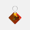 Image of Orchid Attraction photograph printed on a square key chain.