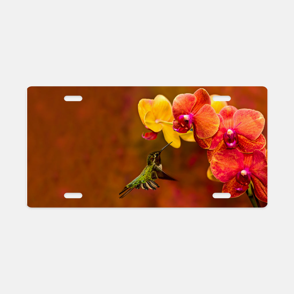 Orchid Attraction photograph printed on a license plate.