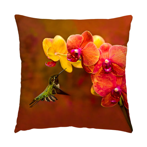 "Orchid Attraction hummingbird photograph on a 20"" square pillow."