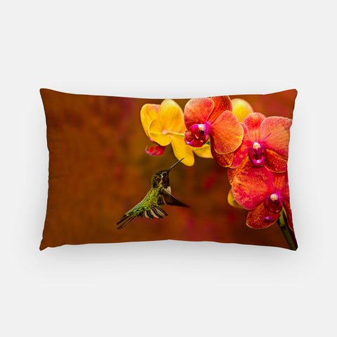 Orchid Attraction photograph printed on a lumbar pillow.