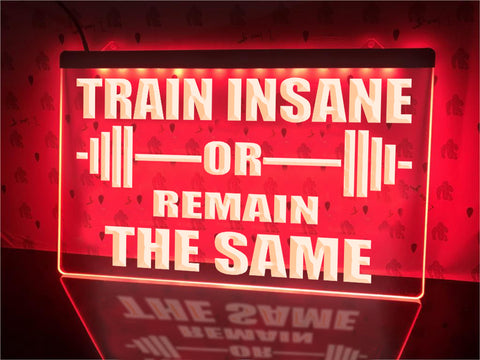Image of Train Insane Illuminated Sign