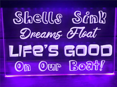 Image of Shells Sink, Dreams Float Illuminated Sign
