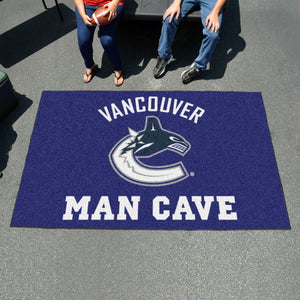 NHL - Vancouver Canucks Man Cave UltiMat 5'x8' Rug