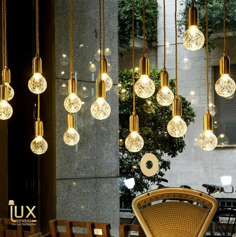 Lux-Lumens | Singapore's Fully-Online Lighting Retail - Pendant Lights, LED Ceiling Lights & Fans. Modern meets Luxury with the Modern Crystal-Bulb Pendant Light. Instant utility savings of up to 40% by fitting the lamp with LED Bulbs. Free Island-wide Delivery - No Minimum Purchase for all BTO, Resale, EC, Condo, Resturants, Cafes, Hotel & Retail Lighting.