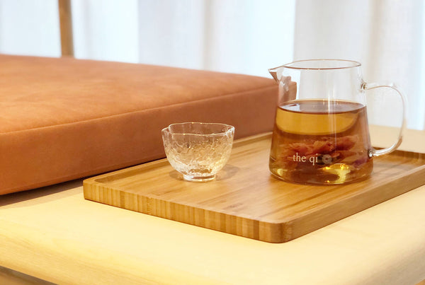 tea tray, glass teacup, and glass server are just a few of the kitchen must haves for tea lovers
