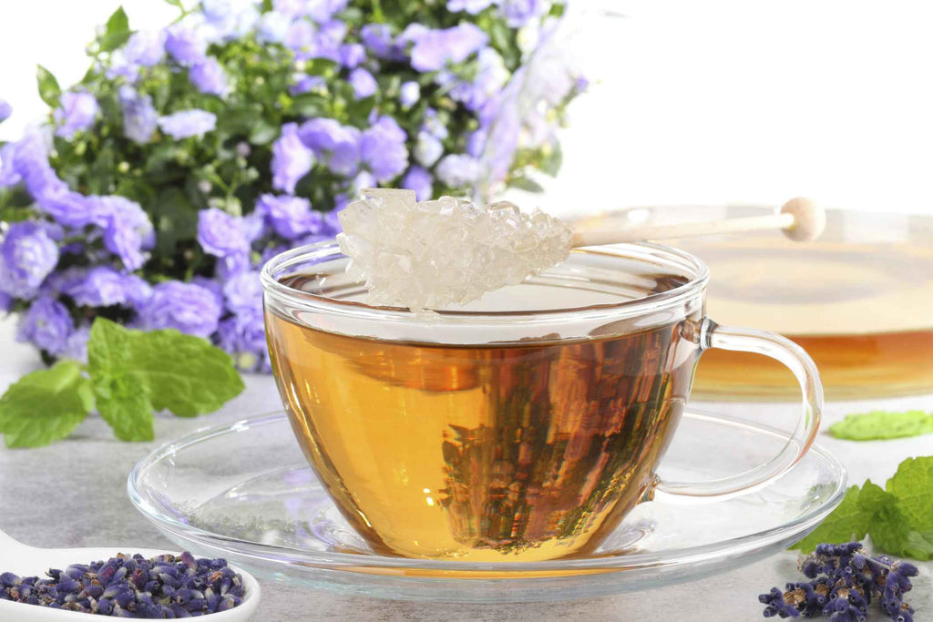 lavender tea in a cup with sugar