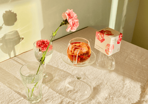 whole flower rose tea organic with flower on table with sunlight