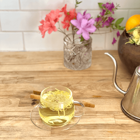 whole flower tea with flowers on kitchen counter
