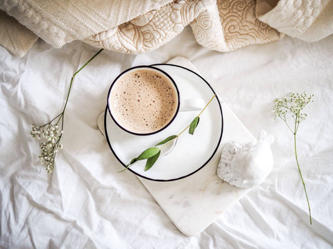 coffee on bed with flowers
