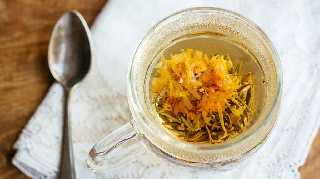 calendula tea with spoon and cup