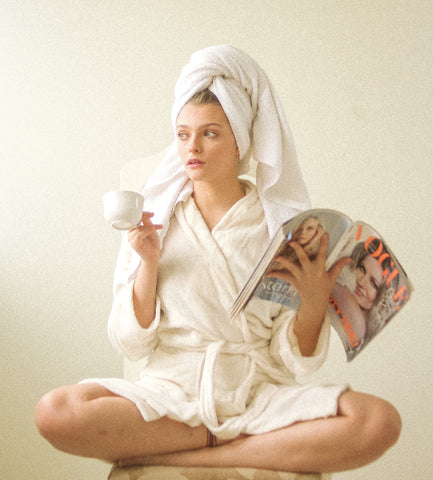 girl in robe drinking tea