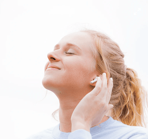 girl listening to music to boost serotonin