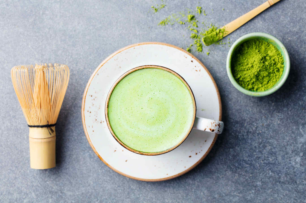 matcha tea and whisk picture