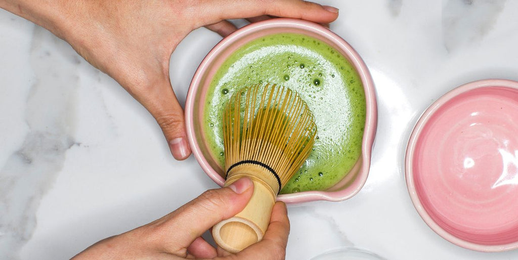 matcha tea and whisk in cup