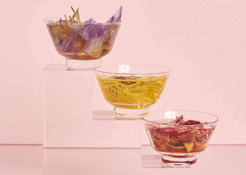 pinming glass tea cups filled with floral tea