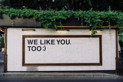 "wall that reads ""We like you too"""