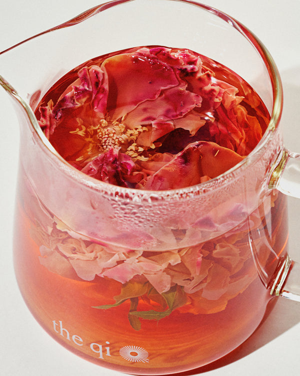 glass server with rose tea