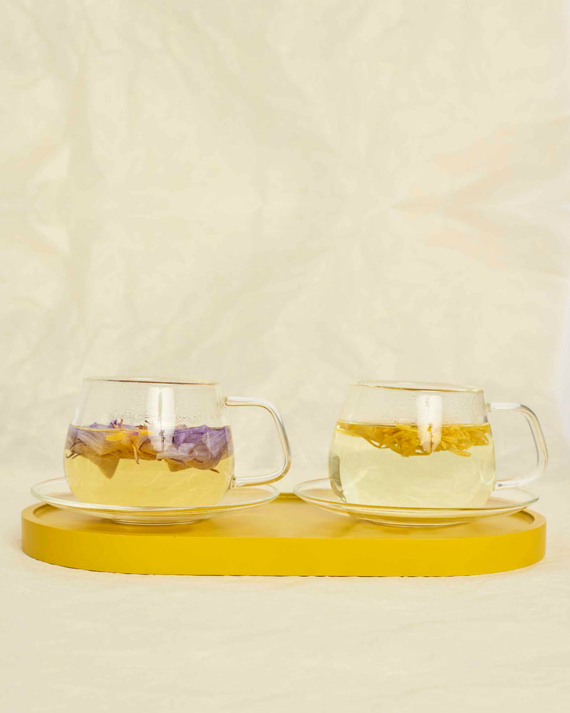 Glass cups + saucers (set of 2)
