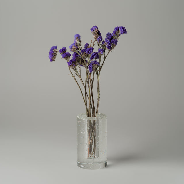 Ferm Living Bubble vase holding dried purple flowers