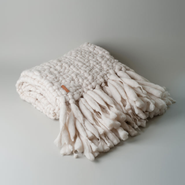 Ecru Dalma throw from Animana made using merino wool