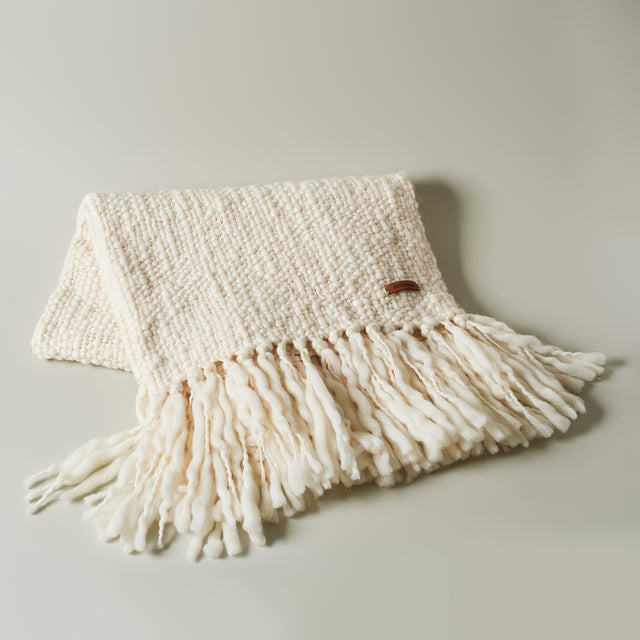 Ecru merino wool Delicia throw from Animana.