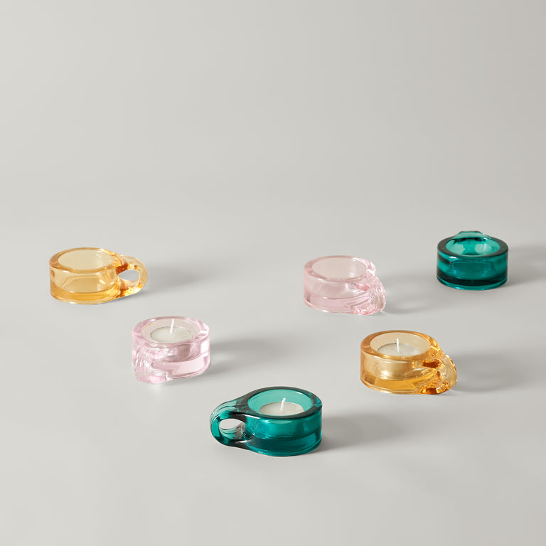 Small glass Floe tea light holders from Normann-Copenhagen in yellow, light pink and turquoise