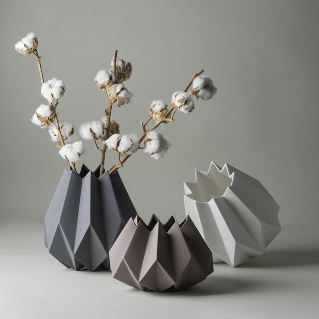 Large Carbon, large white, and small taupe Folded vases from Menu made of clay