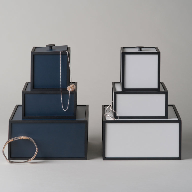 The dark blue and black Frame boxes and the black and white Frame boxes from By Lassen.