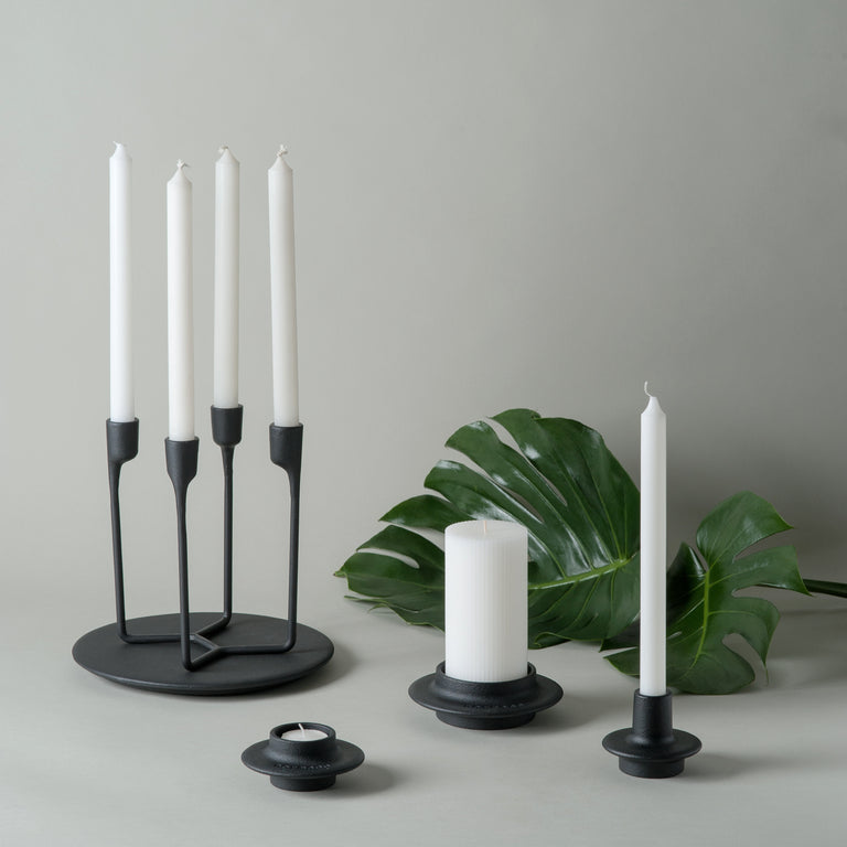 Black cast iron tea light holder, candleholder, Block candleholder and 4-armed candleholder from Normann-Copenhagen's Heima collection