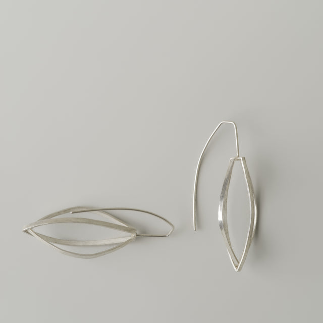 Silver pod skelton earrings
