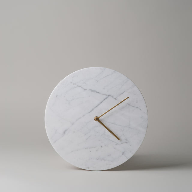 White Marble wall clock with brass hands from Menu.