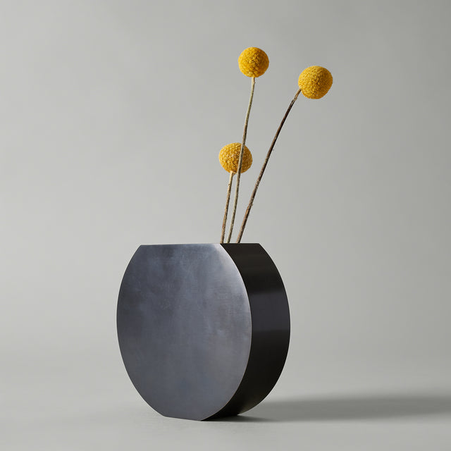 Black and gold solid brass Moon vase from Menu