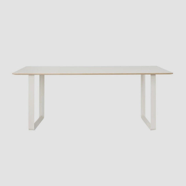 White 170cm 70/70 table designed by TAF Studio for Muuto. The table top is made of plywood with a laminate surface and the frames are made from aluminum.