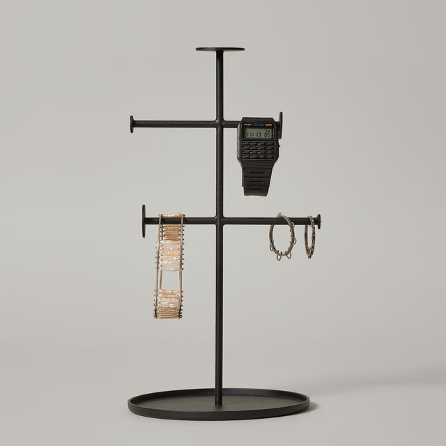 The black powder-coated steel Norm collector designed by Norm Architects for Menu. This jewelry holder is carrying a watch, a bracelet and earrings.