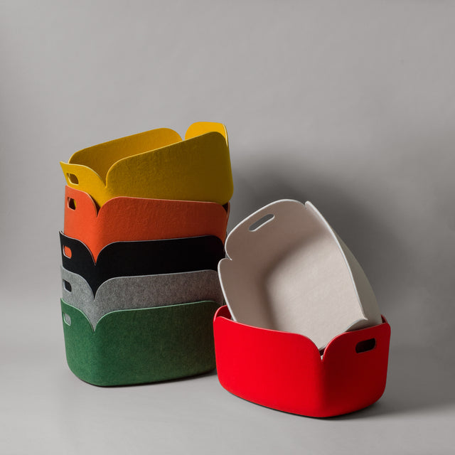 The felt Restore baskets from Muuto in yellow, orange, black, grey, green, sand and red.