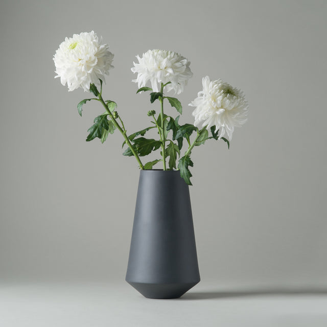 Matte dark grey porcelain Sculpt Well vase from Ferm Living