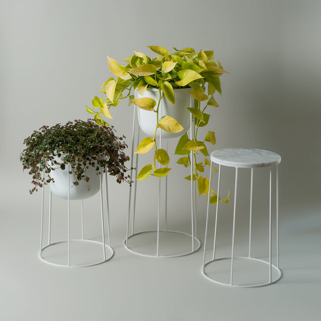 White powder-coated steel Wire planters and side table from Menu