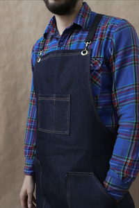 Navy blue denim apron with gold stitching and cross straps