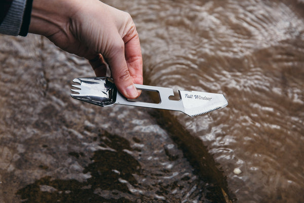 the muncher titanium camping multi utensil easy to clean polished finish being washed in stream