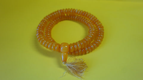 Disc shaped Gold Mala bead.